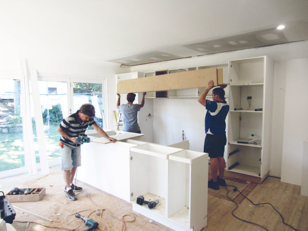 Workers installing a kitchen