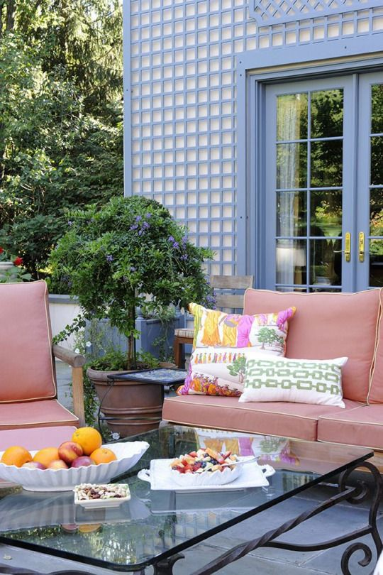 Patio with treillage and pink outdoor furniture