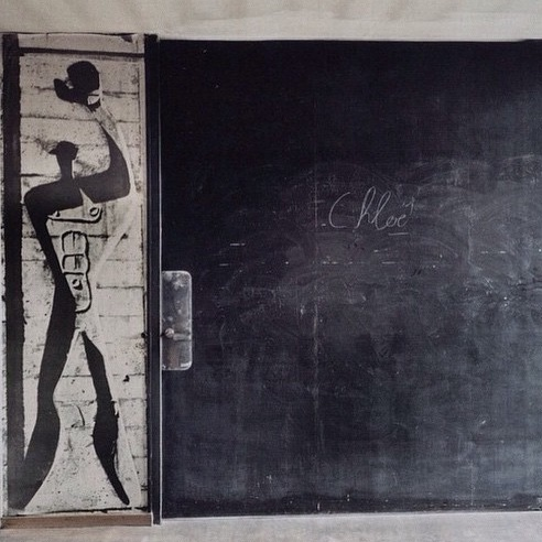 Unusual Black Sliding Door with painting of man holding hat